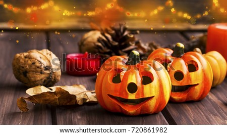Pumpkins fall decoration, halloween celebration decorations with festive pumpkins, chestnuts and acorns assortment with lights