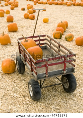 Pumpkins in red wagon - stock photo