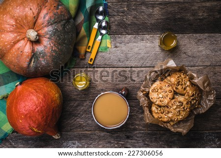 Pumpkins, soup, honey and cookies with nuts on wood. Autumn Season food photo - stock photo
