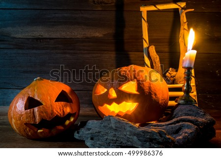 pumpkins with candlestick on wooden background with copy space