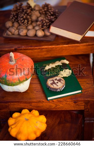 pumpkins with fall leaves and books - stock photo
