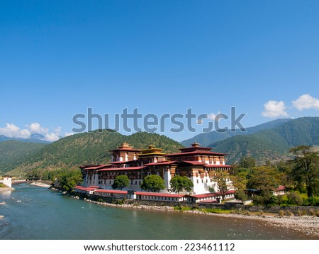 Punakha Dzong and the Mo Chhu river in Bhutan - stock photo