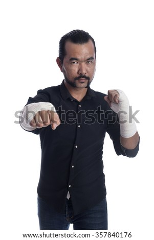 punching man over white background