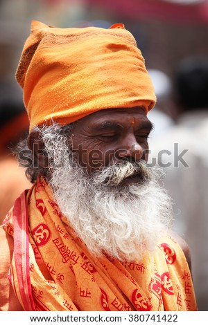 Pune, India - July 11, 2015: An Indian sage of the hindu tradition meditating on his way to a pilgrimmage in India during Wari festival