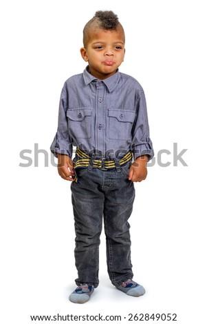 Punished kid resentfully looks away - stock photo