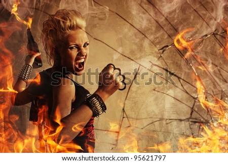 Punk girl throwing a bottle. - stock photo