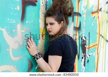 Punk girl walking outdoor - stock photo