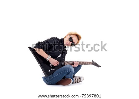 Punk Rockstar playing a guitar isolated in white - stock photo
