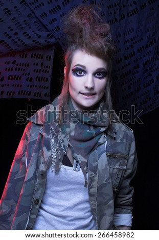 Punk. Young woman with smokey eyes and with artistic hairstyle.