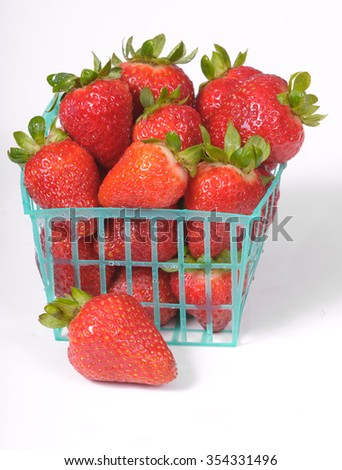 Punnet or basket of fresh strawberries on a white background - stock photo