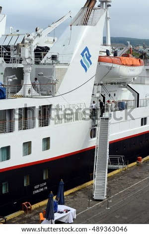 PUNTA ARENAS, CHILE - NOVEMBER 21,2014:Preparation of a passenger vessel to sail in the port of Punta arenas.