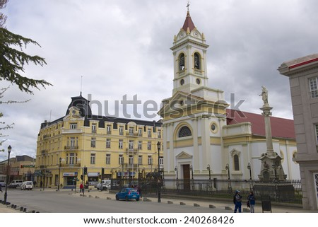 PUNTA ARENAS, CHILE - OCTOBER 28, 2013: Unidentified people walk by the central square in Punta Arens, Chile.