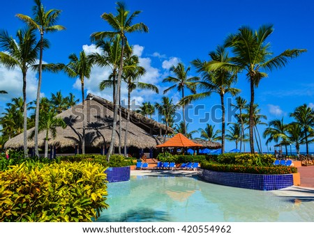 Punta Cana, Dominican Republic - September 26, 2013: interesting exteriors of hotels on the coast, pool and bar