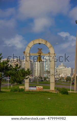 PUNTA DEL ESTE, URUGUAY - MAY 06, 2016: arco de la paz is a small monument located in one of the streets close to the beach