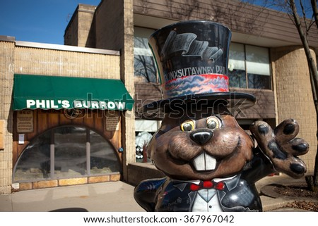 PUNXSUTAWNEY, PA MARCH 29: Statue of Punxsutawney Phil in front of Phils Burrow in downtown Punxsutawney, PA on March 29, 2015. - stock photo