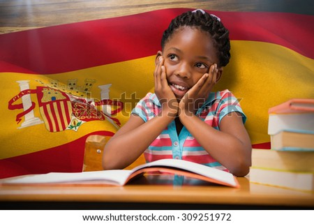 Pupil sitting at her desk against digitally generated spain national flag - stock photo