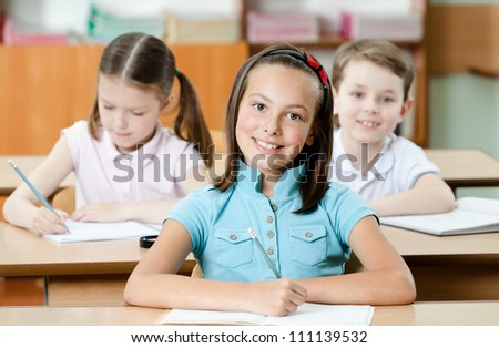 Pupils are are glad to study. They listen to every word of teacher - stock photo