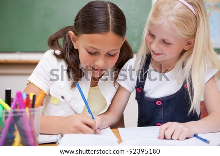 Pupils drawing together in a classroom