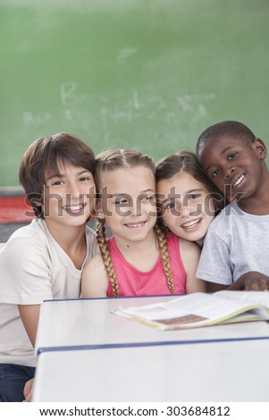 Pupils looking at camera and smiling