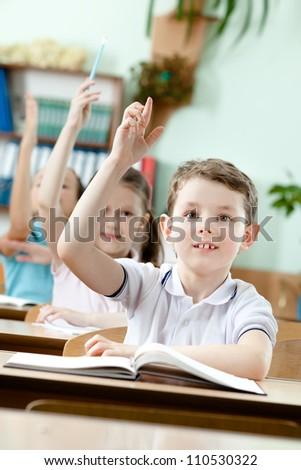 Pupils put their hands upward - stock photo