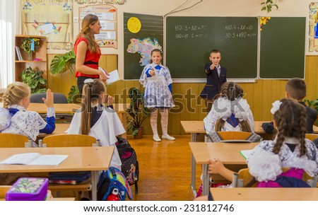 Pupils show a sign board near perfect - stock photo