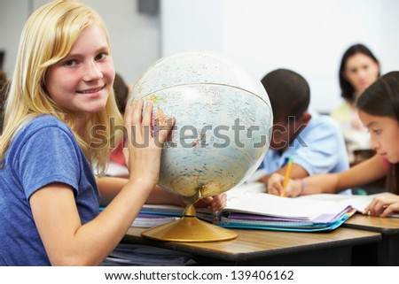 Pupils Studying Geography In Classroom - stock photo