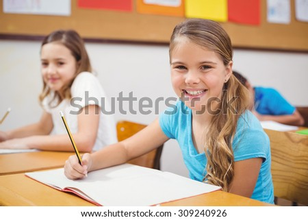 Pupils working at their desk in class at the elementary school