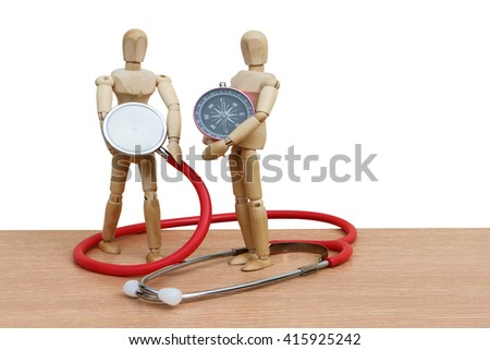 puppet doll holding stethoscope and compass ,health and travel concept ,isolate white background - stock photo