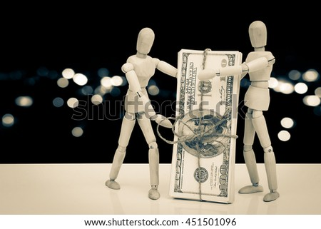 puppet dolls and banknote with  blur bokeh light in city background - stock photo
