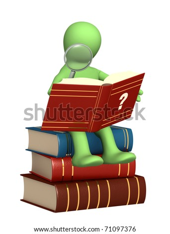 Puppet, reading the dictionary. Isolated over white - stock photo
