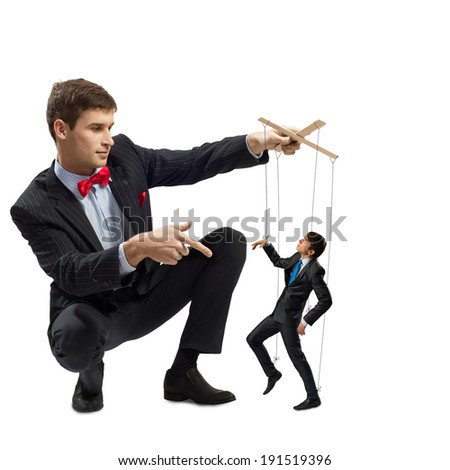puppeteer holds the puppet business man on the ropes - stock photo
