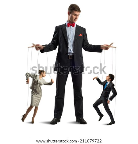 puppeteer keeps business people puppets, concept control business - stock photo