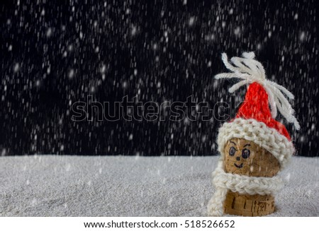 puppets with Christmas-hats and snow falling from the sky