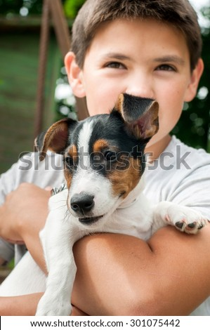 Puppy Jack Russell Terrier at hands