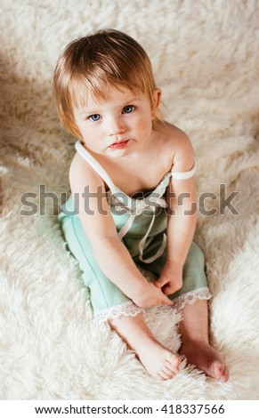 Pure glance of the beautiful little baby - stock photo