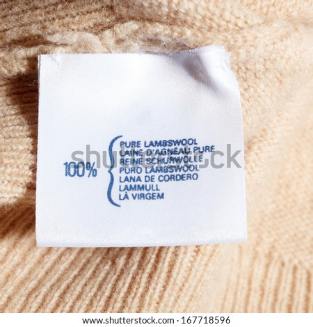 Pure lambswool label on wool jumper - stock photo