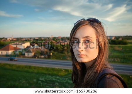 Pure, Natural, Beautiful Young Woman on Soft Nature Background - stock photo