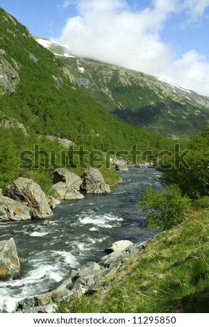 Pure water with boulders, forest, mountain place