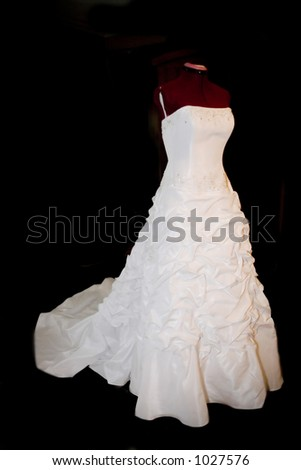 pure white wedding gown against black