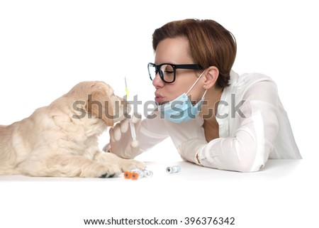 Purebred Golden Retriever Labrador Puppy at Vaccination and Checkup with Professional Veterinarian Clinic Hospital - stock photo