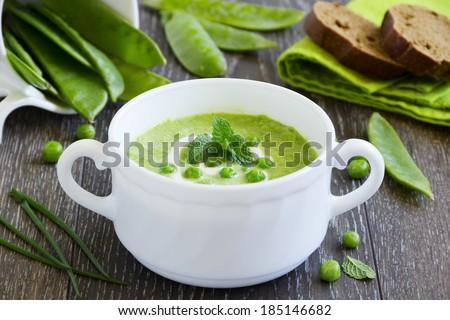Puree the soup young green peas. - stock photo