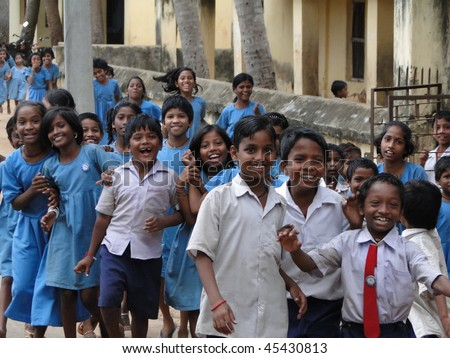 PURI, INDIA - NOV 17 -  Curious Indian school children greet visiting foreign guests   on Nov 17, 2009  in Puri, India
