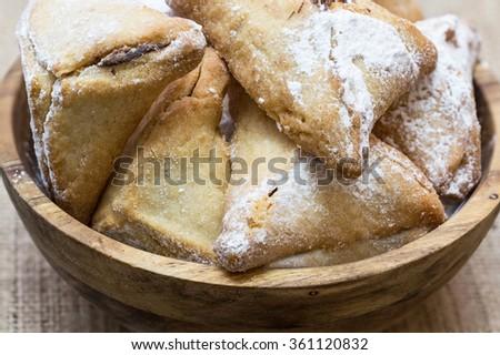 "Purim holiday cookies, chocolate-filled cookies ""Ozne Haman"" in Hebrew. Haman's ears - stock photo"