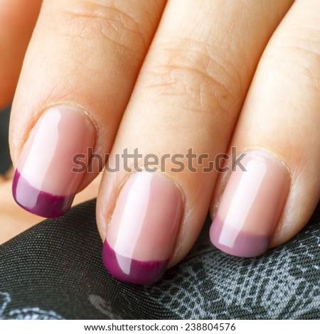 Purple acrylic manicure close up - stock photo