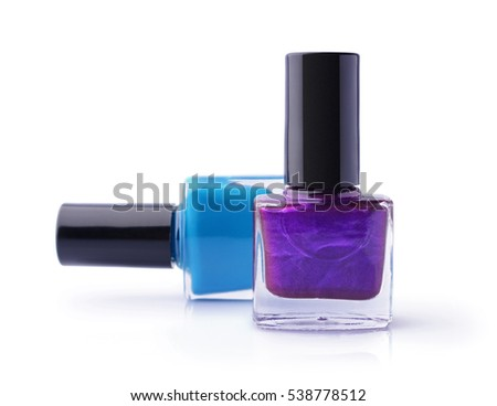 Purple and blue nail polishes isolated on white