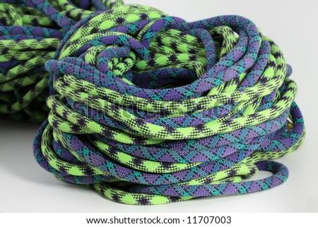 purple and green climbing rope - stock photo