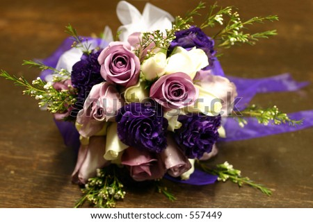 Purple and pink rose bridal bouquet - stock photo