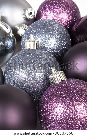 Purple and silver christmas ball background. Festive shiny xmas decoration. - stock photo