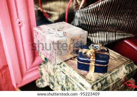 purple and silver jewellery boxes stay on a table. - stock photo