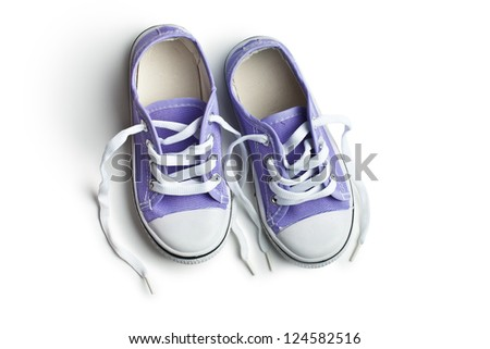 purple baby sneakers on white background